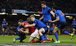 Wales' George North crashes over the line to score the opening try of the game.