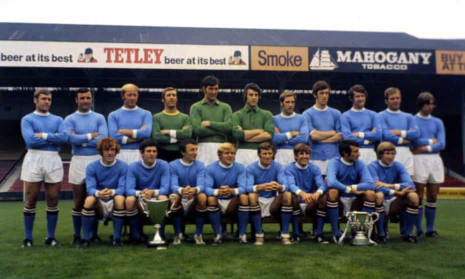 Manchester City players show off their 1970 trophy haul of the European Cup Winners' Cup and the League Cup at Maine Road before the 1970-71 season.