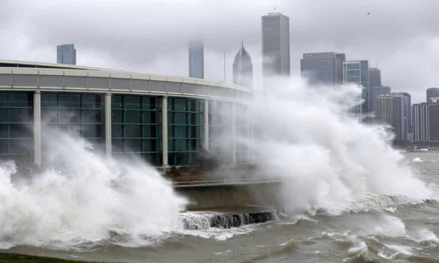 Wind-blown waves from Lake Michigan break around the Shedd aquarium as a winter storm moved across Illinois on Monday.