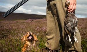 Hunter holding a grouse