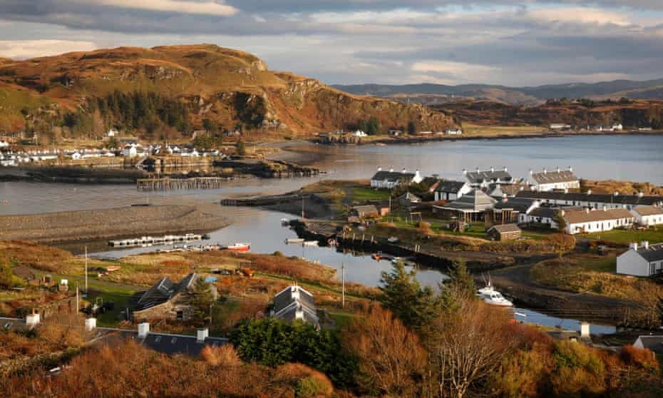 The harbour and village on Easdale Island with Ellenabeich on the Isle of Seil across Easdale Sound.