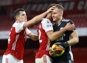 Arsenal's keeper Bernd Leno is congratulated by teammates after saving a penalty from Chelsea's Jorginho.