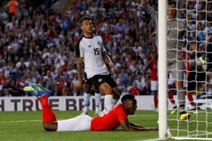 Welbeck connects to score the second for England.