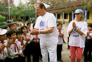 Moore and his wife Kristina on a UNICEF visit to Ha Trung primary school in the Vinh Ha district of Vietnam, on 27 October 2003