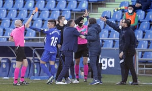 Referee Pablo González Fuertes (left) shows a red card to José Bordalás in the dying moments of Getafe's 1-0 defeat by Real Sociedad.