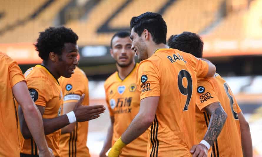 Adama Traoré and Raúl Jiménez celebrate after the Mexican forward struck the winning goal.
