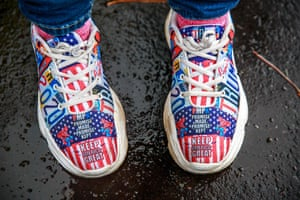 Duluth, US A Trump supporter dons campaign footwear for a Make America Great Again event in Minnesota