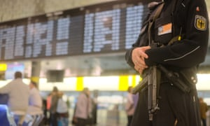 Armed police officer at airport