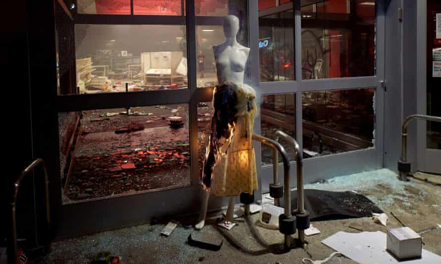 People loot and burn the Target store near the Minneapolis police third precinct.