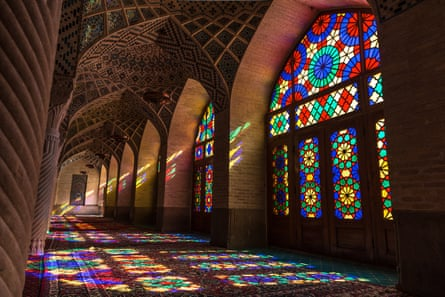 Stained-glass windows cast kaleidoscopic patterns on the floor of Nasir ol Molk mosque, or the Pink Mosque, in Shiraz.