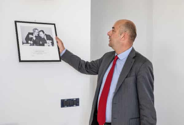 Gianluca Calì holds the photo of the judges Falcone and Borsellino, killed by the mafia in Palermo in 1992