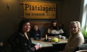 Leah Harper, second from right, and friend enjoy fika in Alingsås with Gunilla (left) and son