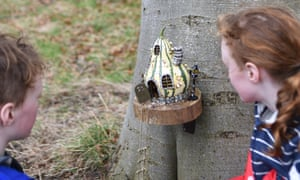 The writer's children look at a fairy house at Archerfield Walled Gardens, Scotland.