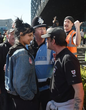 Saffiyah Khan staring down EDL protester Ian Crossland in Birmingham.