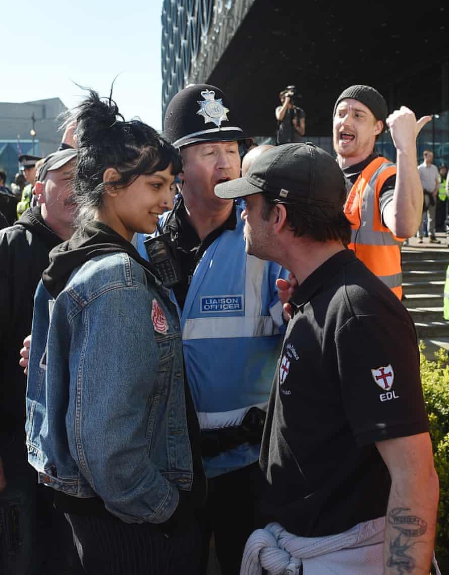 Saffiyah Khan staring down EDL protester Ian Crossland in Birmingham.