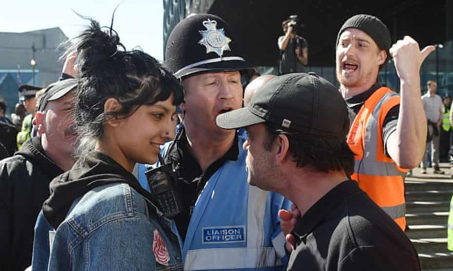Saffiyah Khan and an EDL protester