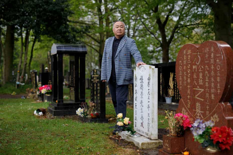 Perry Lee, standing by his father's grave in Everton cemetery.
