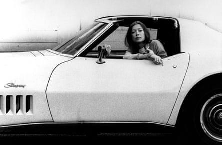 Joan Didion, in white Stingray car,1970.
