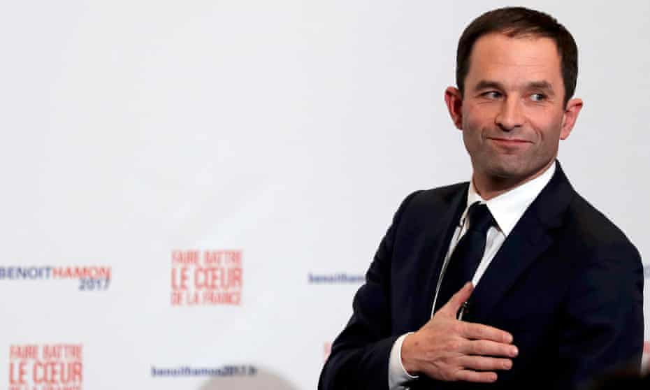 Former French education minister Benoît Hamon reacts after partial results in the second round of the French left's presidential primary election in Paris on Sunday.