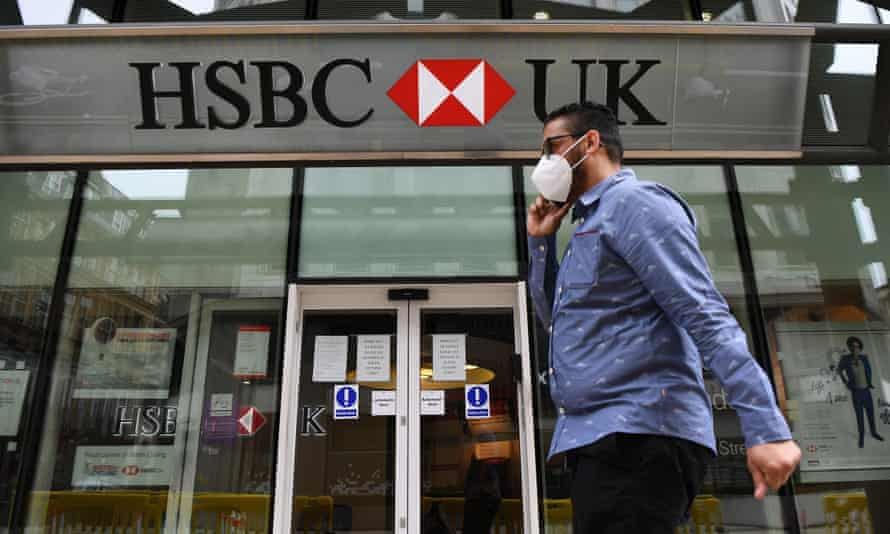 A pedestrian passes a HSBC bank branch in central London