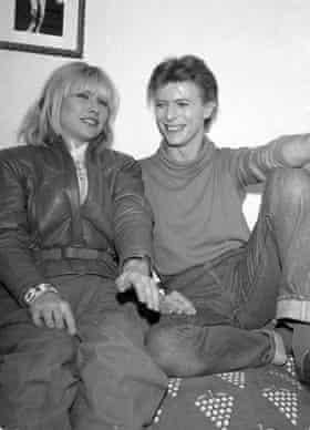 Harry with David Bowie in 1980.