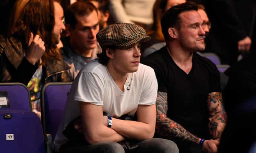 Brooklyn Beckham wearing an old-fashioned style cap.