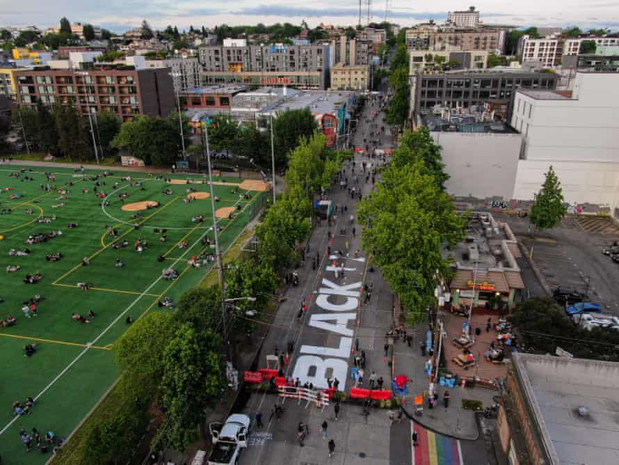 The beginnings of a Black Lives Matter mural begins to take shape on East Pine Street in the 'Capitol Hill Autonomous Zone' on Wednesday in Seattle, Washington.