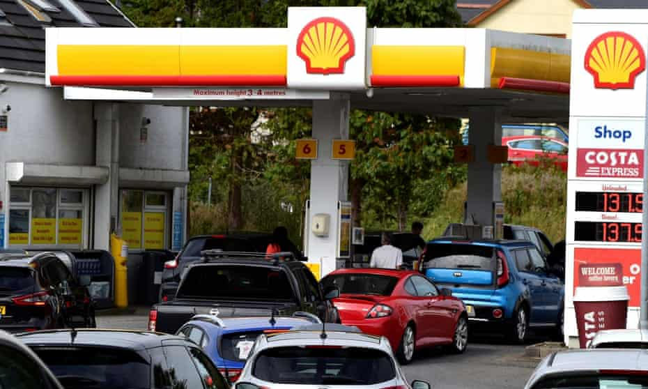 Cars queue up at a petrol and diesel filling station in Begelly, Pembrokeshire, Wales.