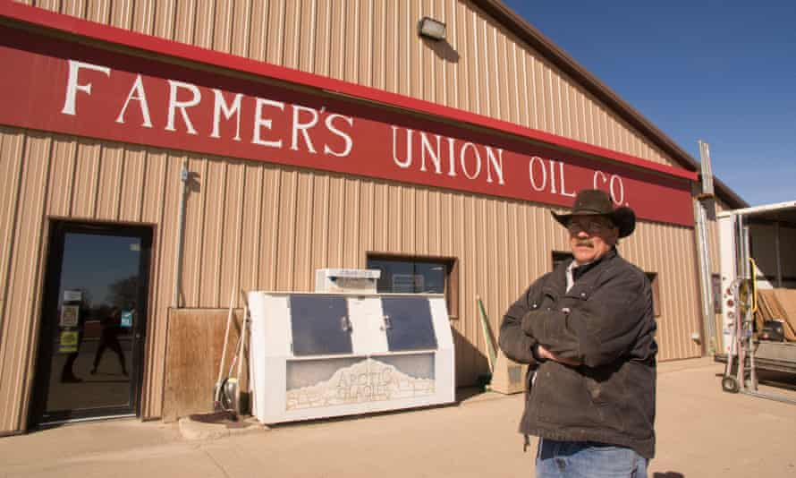 Perkins County commissioner Rusty Foster stands outside a gas station in the town of Faith, South Dakota.