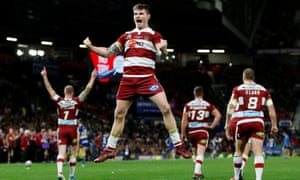 Wigan Warriors' John Bateman celebrates his side's victory over Warrington Wolves in the Super League Grand Final at Old Trafford.