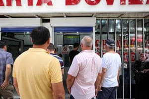 People look at foreign exchange rates in Ankara, Turkey, today.