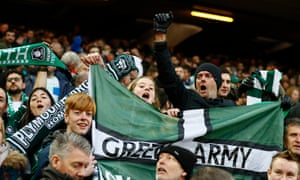 Plymouth Argyle fans celebrate after the draw at Anfield.