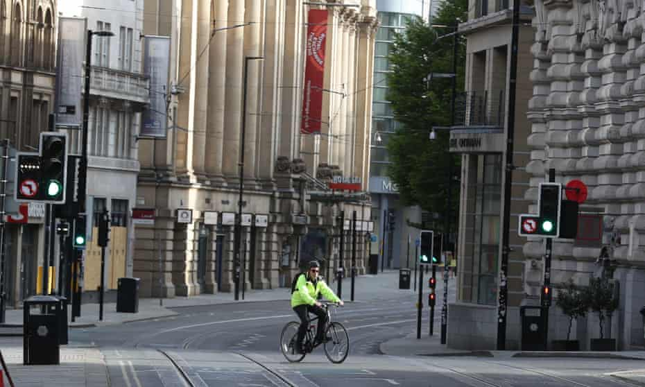 A cyclist in an empty Manchester street last month