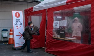 A woman enters a Covid-19 testing booth outside the Yangji hospital in Seoul.