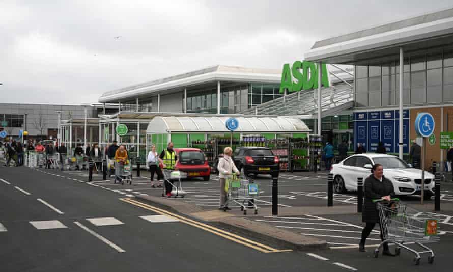 Shoppers queueing at an Asda in Gateshead.