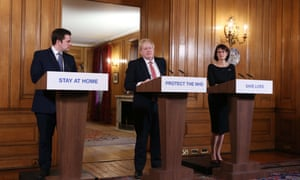 Robert Jernick, Boris Johnson and Jenny Harries give a press briefing at Downing Street on 22 March.