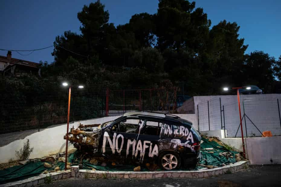 The BMW X5 of Gianluca Calì, burned in a mafia attack in November 2015, is today parked at the Calì's car dealership as an anti-mafia memorial