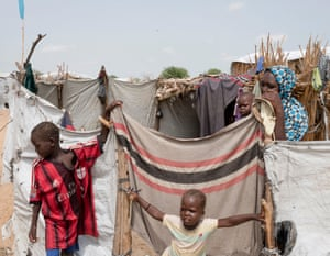 Two young boys play in a refugee camp in Dar es Salaam.