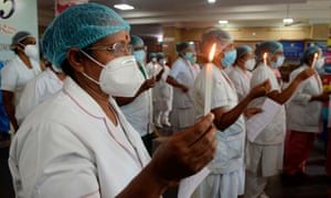 Nurses light candles at Rajiv Gandhi hospital in Kochi to mark international nurses day.