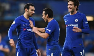 Davide Zappacosta celebrates with teammates Pedro and Marcos Alonso after scoring Chelsea's fifth goal.