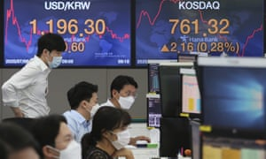 Currency traders at the foreign exchange dealing room of the KEB Hana Bank headquarters in Seoul, South Korea, today