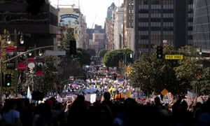 Tens of thousands of people took to the streets of Downtown Los Angeles for the Women's March in protest after the inauguration of President Donald Trump.