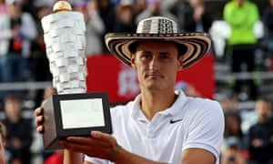 Tomic holds up the Claro Open trophy for the second time.