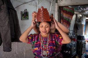 Ana Monroy, 2017-2018 indigenous queen of San Pedro Sacatepéquez, in her mother's house.