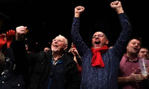 Supporters of Germany's SPD celebrate news of the exit poll in Hamburg.