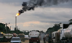 Tankers wait at a refinery near Port Harcourt,Nigeria