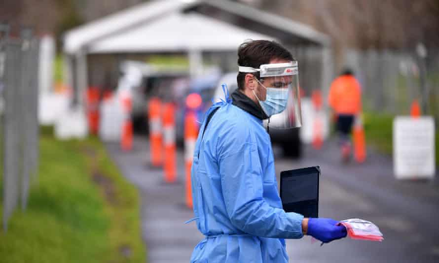 A healthcare worker at a drive-through Covid-testing facility in Melbourne, Victoria, on Wednesday. The state recorded 22 new cases of locally acquired coronavirus.