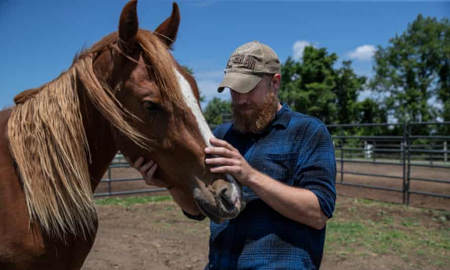 Phil Wytrwa spends time with a mustang named Tango.