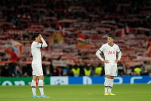 Tottenham Hotspur's Son Heung-min (left) and Erik Lamela look dejected after the final whistle.