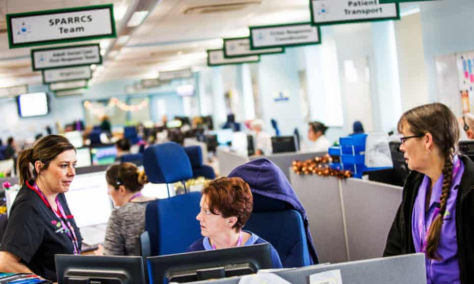 Inside the unique integrated crisis hub of the Isle of Wight NHS trust at St. Mary's Hospital, Newport. There are 999 and 111 operators, social workers, district nurses and more, all together in one room answering emergency calls. For NHS Special. Photograph by Felix Clay